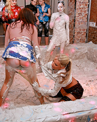 Hot teen lesbian girls love playing in a tub of wet mud